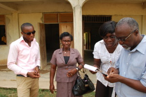 Miss Cecilia, headmistress, and others outside of Okyerekrom Junior High School